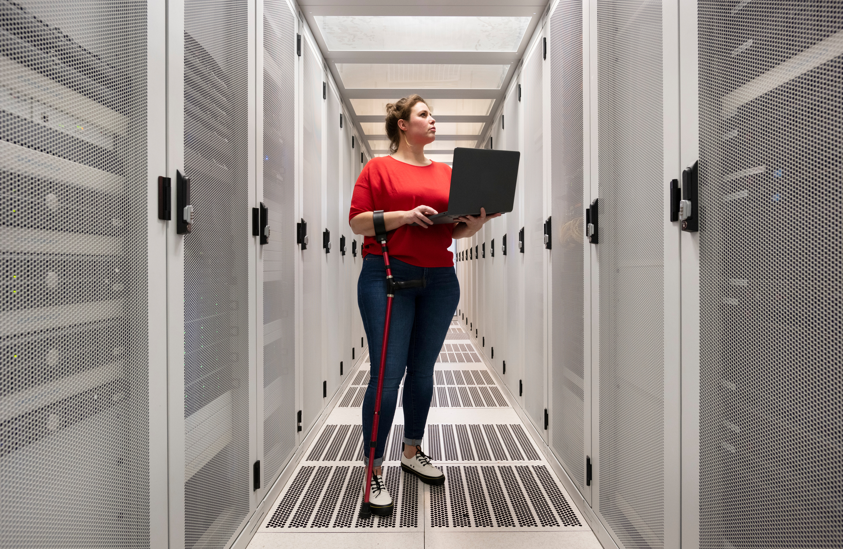 women-with-red-shirt-standing-in-a-server-hall.jpg